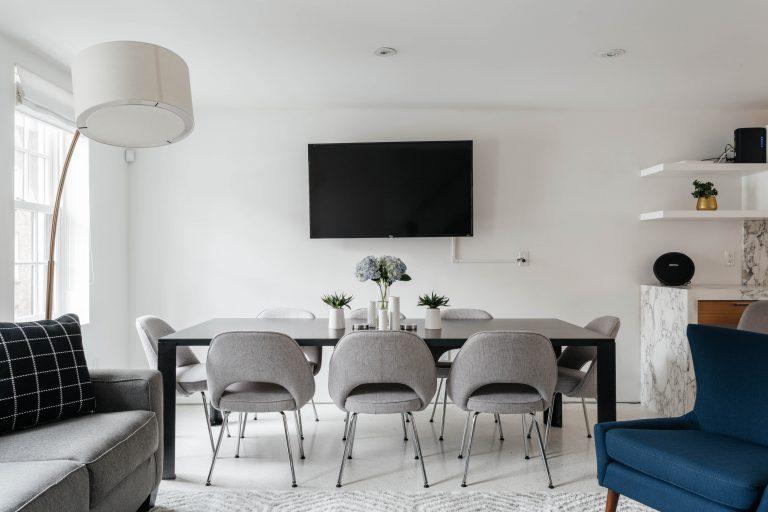 Modern living dining room in white, grey, blue