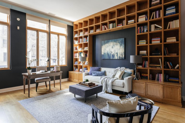 large library with wooden bookshelves and home office