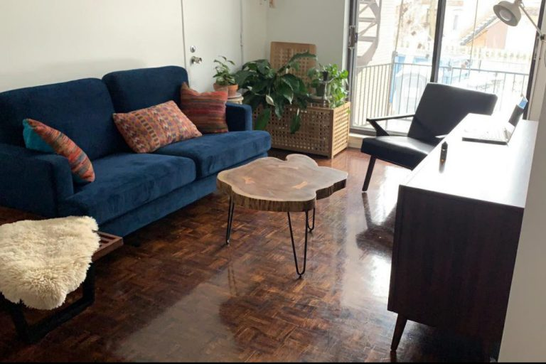 Midcentury modern living room with blue sofa, live edge coffee table and walnut sideboard