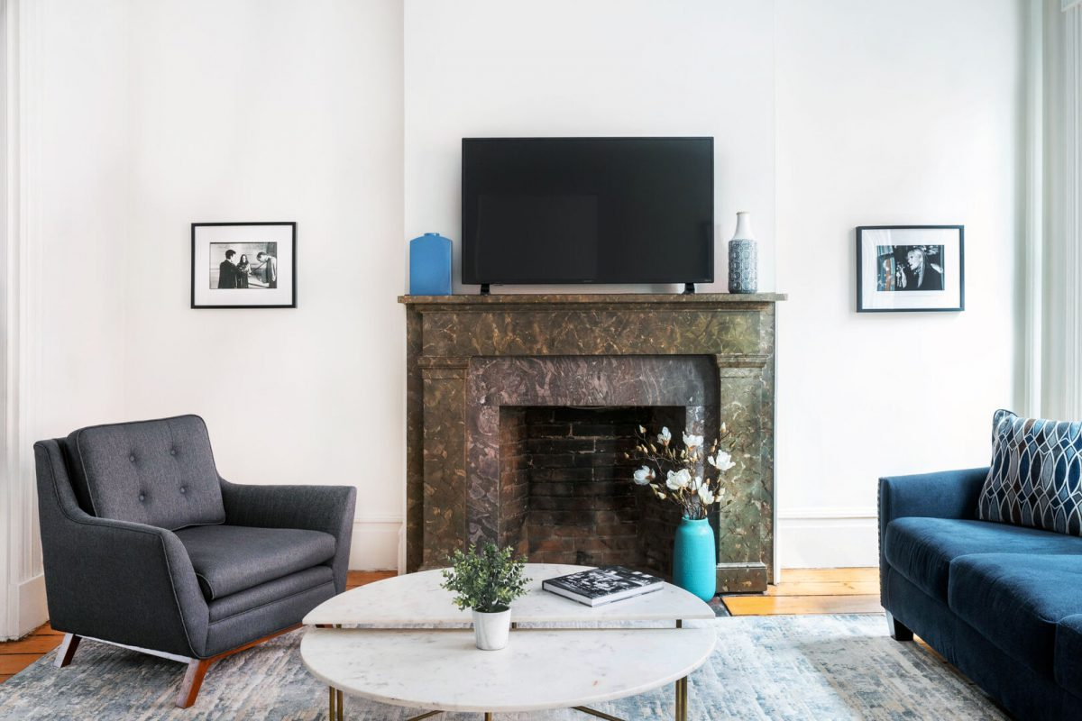 Jason's west village airbnb living room with a fireplace, coffee table, a chair and a couch