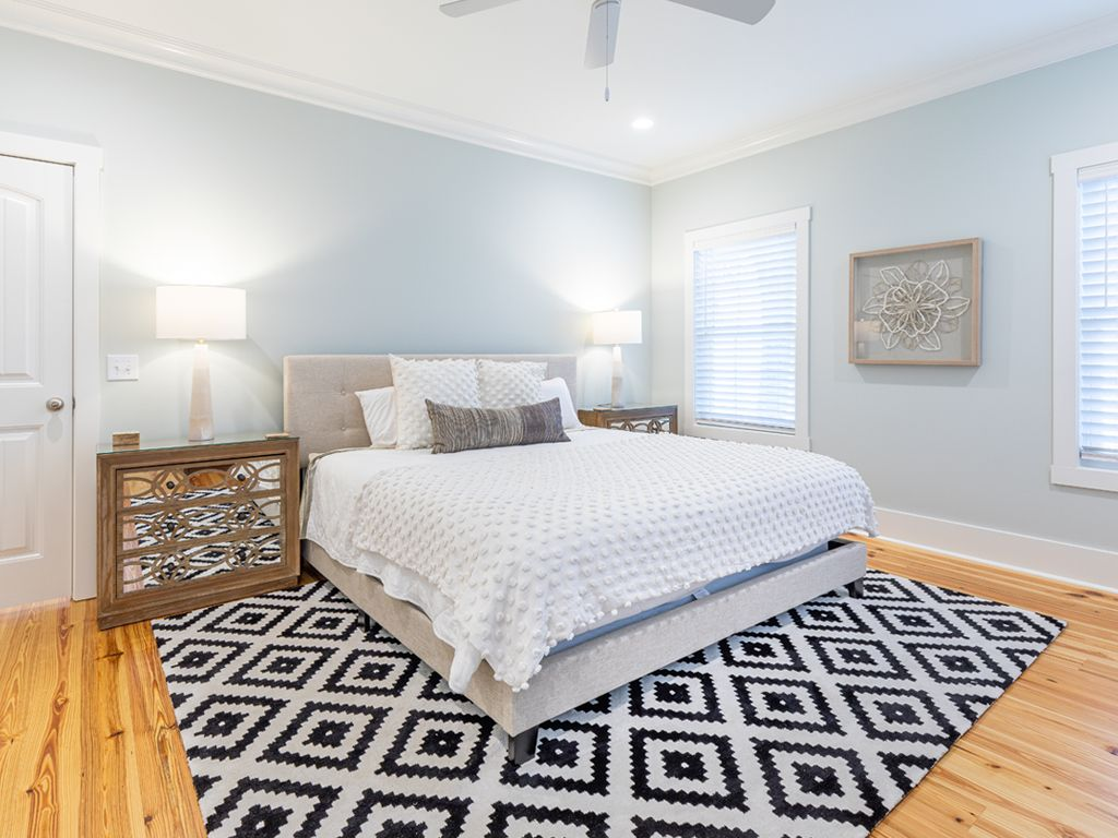 Large bedroom with patterned rug