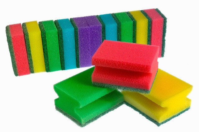 A selection of colorful sponges on a white background